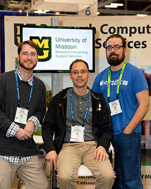 George Robb, Timothy Middelkoop, and Michael Quinn at the MU booth at Supercompute 2015.